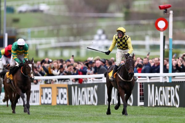 CHELTENHAM, ENGLAND - MARCH 15: Jockey Paul Townend celebrates with horse Al Boum Photo following their victory in The Magners Cheltenham Gold Cup Steeple Chase ahead of Barry Geraghty and horse Anibale Fly during the Gold Cup Day at Cheltenham Festival at Cheltenham Racecourse on March 15, 2019 in Cheltenham, England. (Photo by Michael Steele/Getty Images)