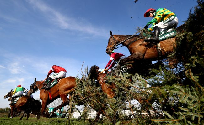 LIVERPOOL, ENGLAND - APRIL 06: JJ Burke riding RegaL Encore (R) and Davy Russell riding Tiger Roll (L) clear the Canal Turn during the Randox Health Grand National Handicap Chase at Aintree Racecourse on April 06, 2019 in Liverpool, England. (Photo by Michael Steele/Getty Images)