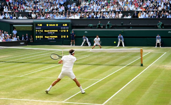 LONDON, ENGLAND - JULY 14: Roger Federer of Switzerland plays a forehand in his Men's Singles final against Novak Djokovic of Serbia during Day thirteen of The Championships - Wimbledon 2019 at All England Lawn Tennis and Croquet Club on July 14, 2019 in London, England. (Photo by Matthias Hangst/Getty Images)