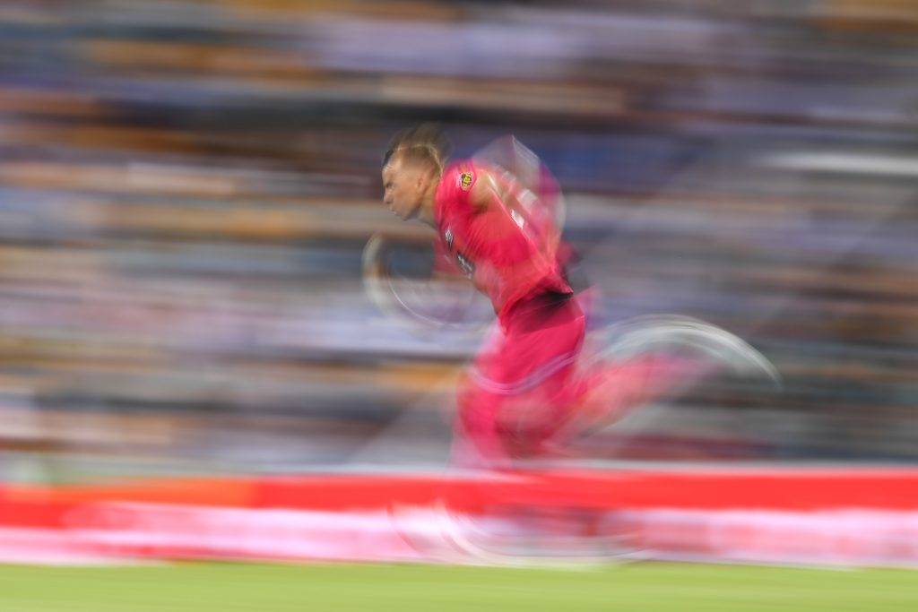 BRISBANE, AUSTRALIA - JANUARY 23: Tom Curran of the Sixers bowls during the Big Bash League match between the Brisbane Heat and the Sydney Sixers at The Gabba on January 23, 2020 in Brisbane, Australia. (Photo by Albert Perez/Getty Images)