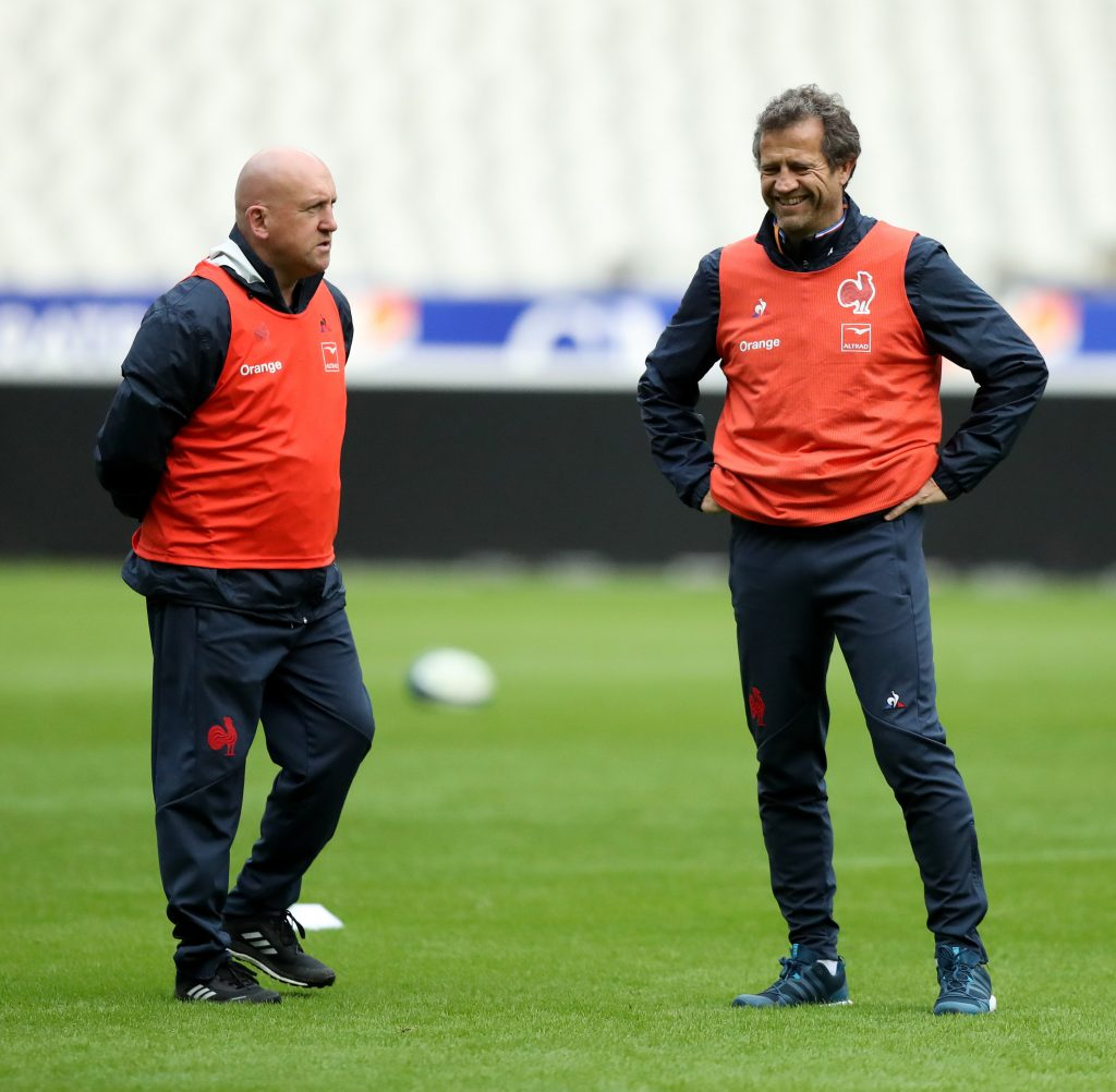 PARIS, FRANCE - FEBRUARY 01: Fabien Galthie, (R) the France head coach, talks with the defence coach Shaun Edwards during the France Captain's run at the Stade de France on February 01, 2020 in Paris, France. (Photo by David Rogers/Getty Images)