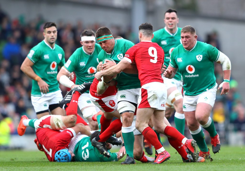 DUBLIN, IRELAND - FEBRUARY 08: CJ Stander of Ireland is tackled by Tomos Williams of Wales during the 2020 Guinness Six Nations match between Ireland and Wales at Aviva Stadium on February 08, 2020 in Dublin, Dublin. (Photo by Warren Little/Getty Images)