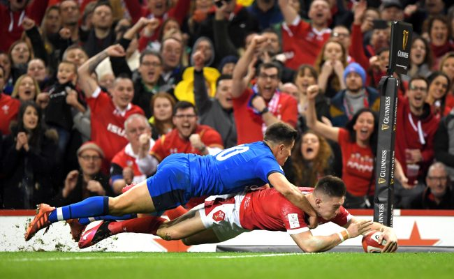 CARDIFF, WALES - FEBRUARY 01: Josh Adams of Wales scores his sides first try as he is challenged by Tommaso Allan of Italy during the 2020 Guinness Six Nations match between Wales and Italy at Principality Stadium on February 01, 2020 in Cardiff, Wales. (Photo by Stu Forster/Getty Images)