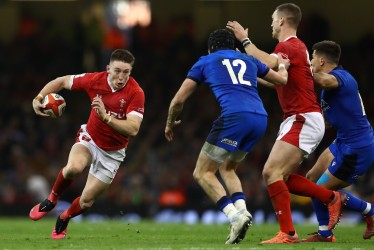 CARDIFF, WALES - FEBRUARY 01: Josh Adams of Wales runs at Carlo Canna of Italy during the 2020 Guinness Six Nations match between Wales and Italy at Principality Stadium on February 01, 2020 in Cardiff, Wales. (Photo by Michael Steele/Getty Images)