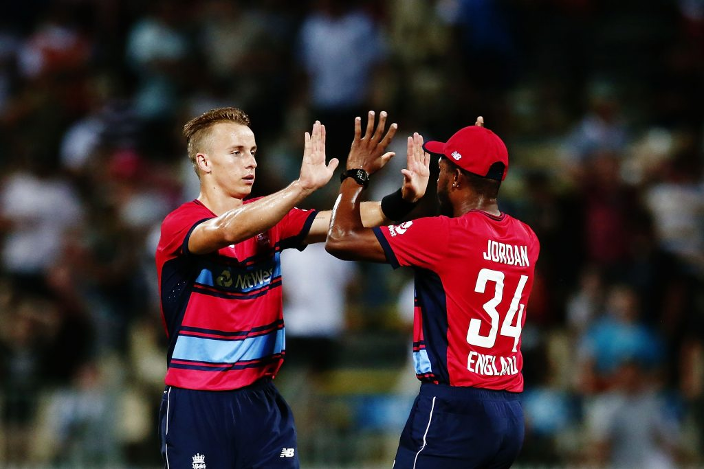 HAMILTON, NEW ZEALAND - FEBRUARY 18: Tom Curran and Chris Jordan of England celebrate after winning the International Twenty20 match between New Zealand and England at Seddon Park on February 18, 2018 in Hamilton, New Zealand. (Photo by Anthony Au-Yeung/Getty Images)